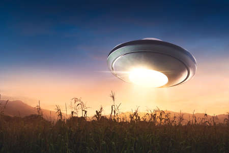 UFO Flying over a corn field at sunset