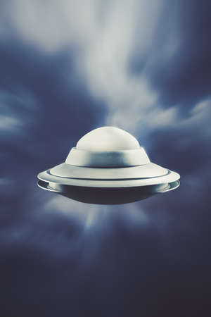 levitate: UFO Flying in the sky with motion blur Stock Photo