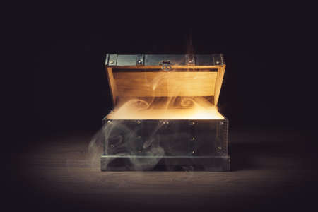 pandoras box with smoke on a wooden background Stok Fotoğraf