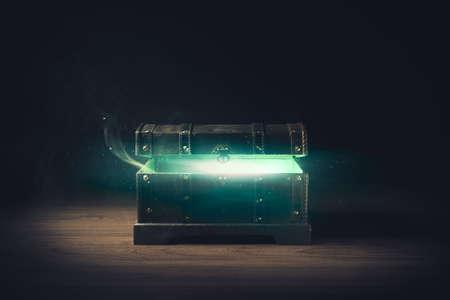 パンドラの箱を開く緑の木製の背景の煙高コントラストの画像
