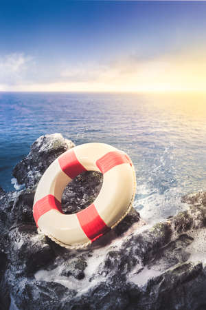 security: life preserver ring on a rocky surface at sea