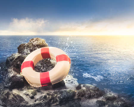 life preserver ring on a rocky surface at sea