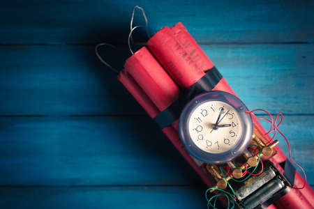 High contrast image of a time bomb on a wooden background