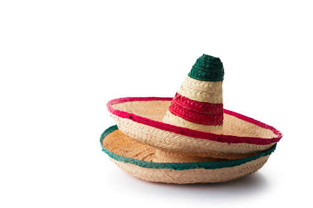 Mexican hats or sombreros stacked up on top of each other, isolated on white Фото со стока