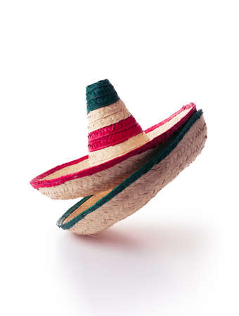 Mexican hats or sombreros stacked up on top of each other, isolated on white Stock Photo