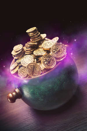 pot full of gold coins on a wooden surface and dark background  saint patricks day concept Stock Photo