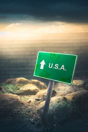 protectionism: Mexico  US border concept with high wall and dramatic lighting Stock Photo