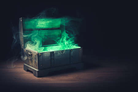 pandoras box with smoke on a wooden background Archivio Fotografico