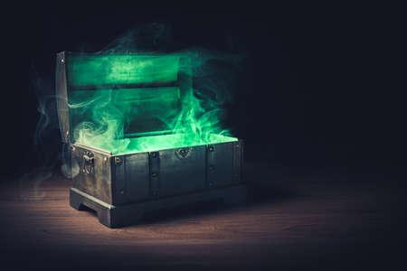 pandoras box with smoke on a wooden background Stockfoto