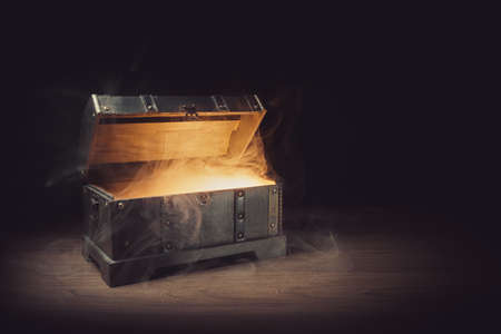 pandoras box with smoke on a wooden background Stockfoto