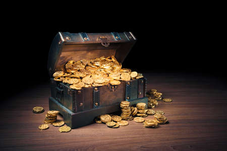 antique: Open treasure chest filled with gold coins  HIgh contrast image Stock Photo