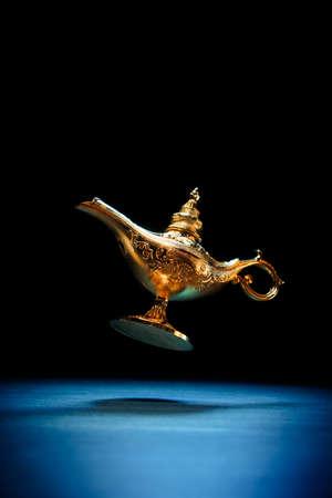 golden: Magic genie lamp floating on a dark background