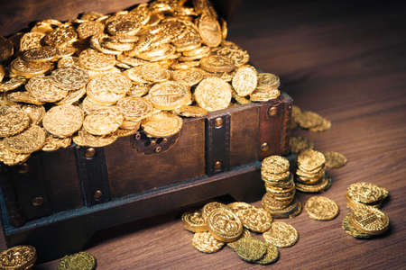 find: Open treasure chest filled with gold coins  HIgh contrast image Stock Photo