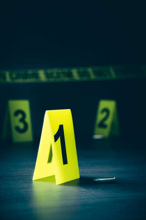 High contrast image of a crime scene with evidence markers Stock Photo