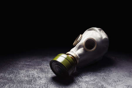 Gas mask with a smoky background