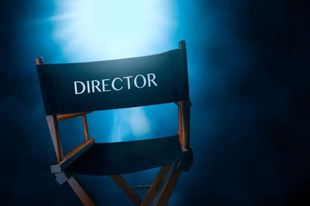 Back of a vintage director chair on a smokey background , high contrast image Stock Photo