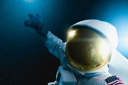 Astronaut floating in outer space , high contrast image Stock Photo