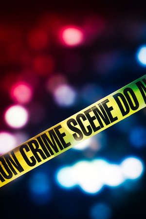 Crime scene tape with red and blue lights on the background Stock Photo
