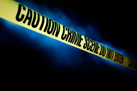 Crime scene tape with smoke on a black background Stock Photo