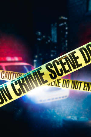 police car at a crime scene with police tape, high contrast image Stock Photo