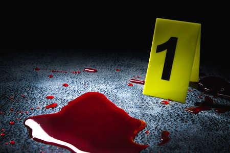 evidence markers on the floor with blood puddle, high contrast image