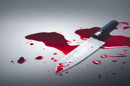 bloody knife on a gray background