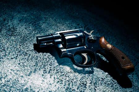 gun on the street floor, high contrast image