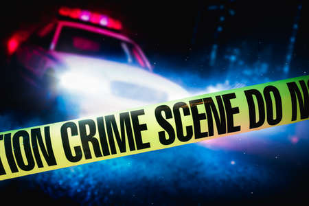 police car at a crime scene with police tape, high contrast image Stockfoto