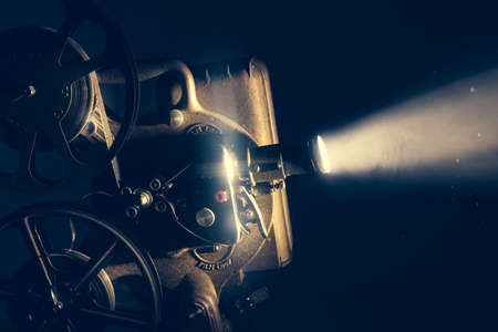 Film projector with dramatic lighting , high contrast image
