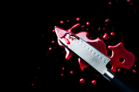 bloody knife isolated on black, high contrast image Stock Photo