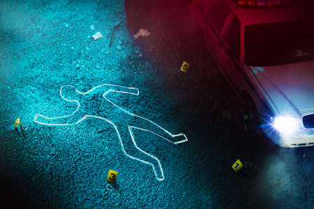 Crime scene with body outline, evidence markers and a police car with dramatic lighting 写真素材
