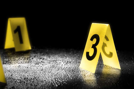 evidence markers on the floor, high contrast image
