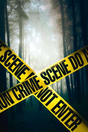 Crime scene tape in the woods Stock Photo
