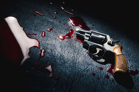 crime scene concept with a gun on a blood puddle, high contrast image Archivio Fotografico