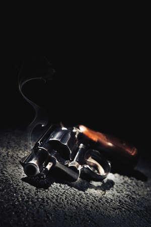 Smoking gun on the floor, high contrast image