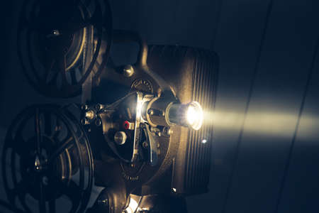 Film projector with dramatic lighting, high contrast image