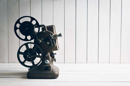 Film projector on a white wooden background Stock Photo