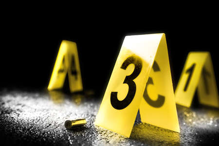 evidence markers on the floor, high contrast image Imagens