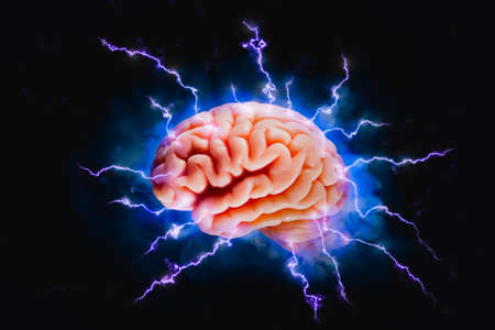 Brainstorming concept with human brain floating on a dark background Imagens