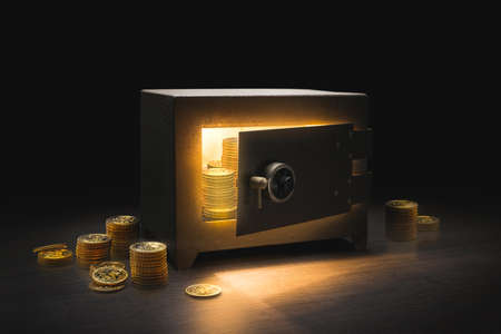 Steel money bank safe on a dark background / dramatic lit image