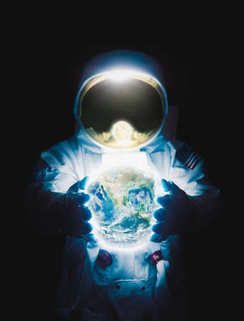Astronaut holding planet earth high contrast image Stock Photo