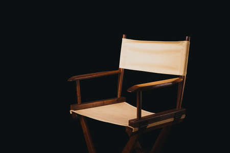 Vintage director chair on a black background Stock Photo