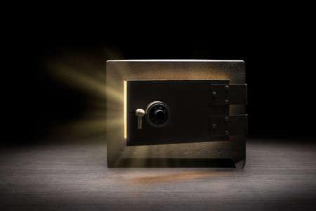 Steel money bank safe on a dark background  dramatic lit image