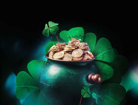 Saint Patricks day background with gold pot and four leaf clovers on a dark background  high contrast image Stock Photo