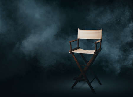 Vintage director chair on a smokey background Stock Photo