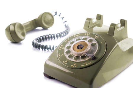 Vintage green telephone isolated on white