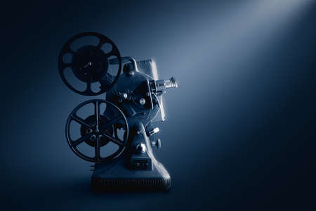 Movie projector on a dark background  high contrast image Stock Photo