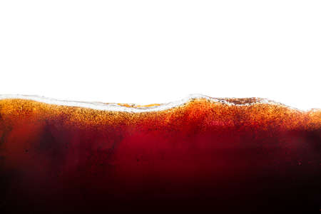 Side view background of refreshing cola flavored soda with bubbles isolated on white Stock Photo