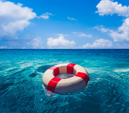 Life saver ring floating in the ocean on a sunny day Stock Photo