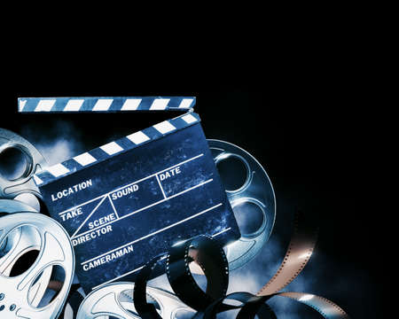 Cinema background with movie projector and film reels on a dark background  high contrast image